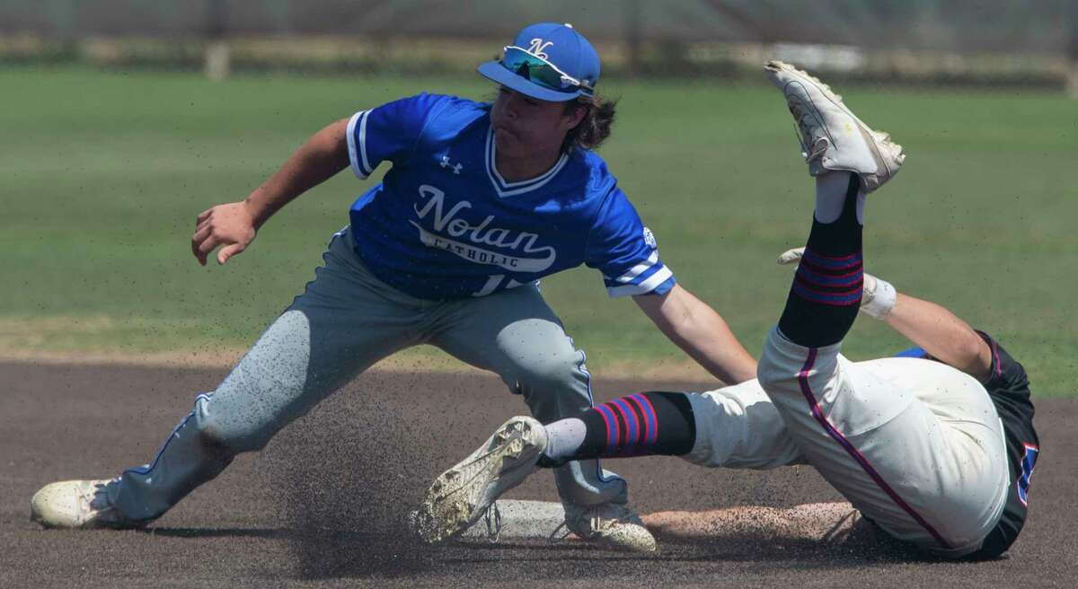 FW Nolan Catholic's Devon Ashcraft makes the tag for an out as Midland Christian's Luke Greenlee tries to steal second and slide around the tag 04/24/2021 at Christensen Stadium. Tim Fischer/Reporter-Telegram
