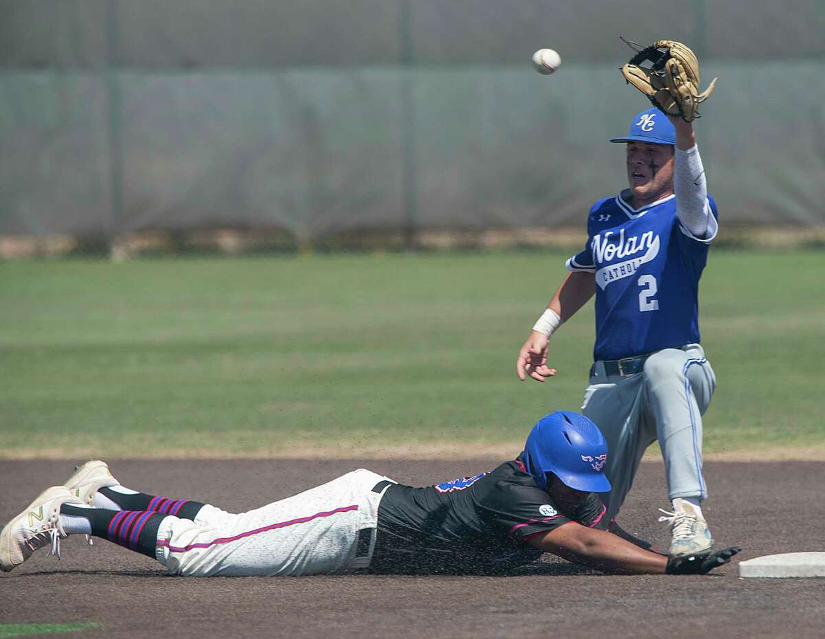 Midland Christian's Jacob Hicks gets his hand stepped on as he safely dives back to second as FW Nolan Catholic's Blake LaLonde looks to make a tag on a pickoff attempt 04/24/2021 at Christensen Stadium. Tim Fischer/Reporter-Telegram