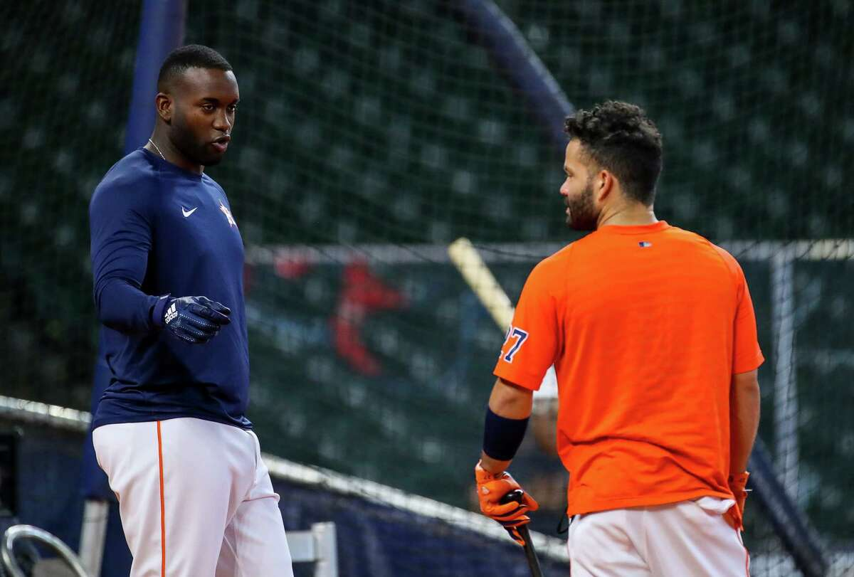 Houston Astros designated hitter Yordan Alvarez (44) talks with second baseman Jose Altuve (27) during batting practice before an MLB game between the Astros and the Los Angeles Angels at Minute Maid Park on Saturday, April 24, 2021, in Houston. Altuve is not yet back in the lineup since being placed in the COVID-19 list on April 14.