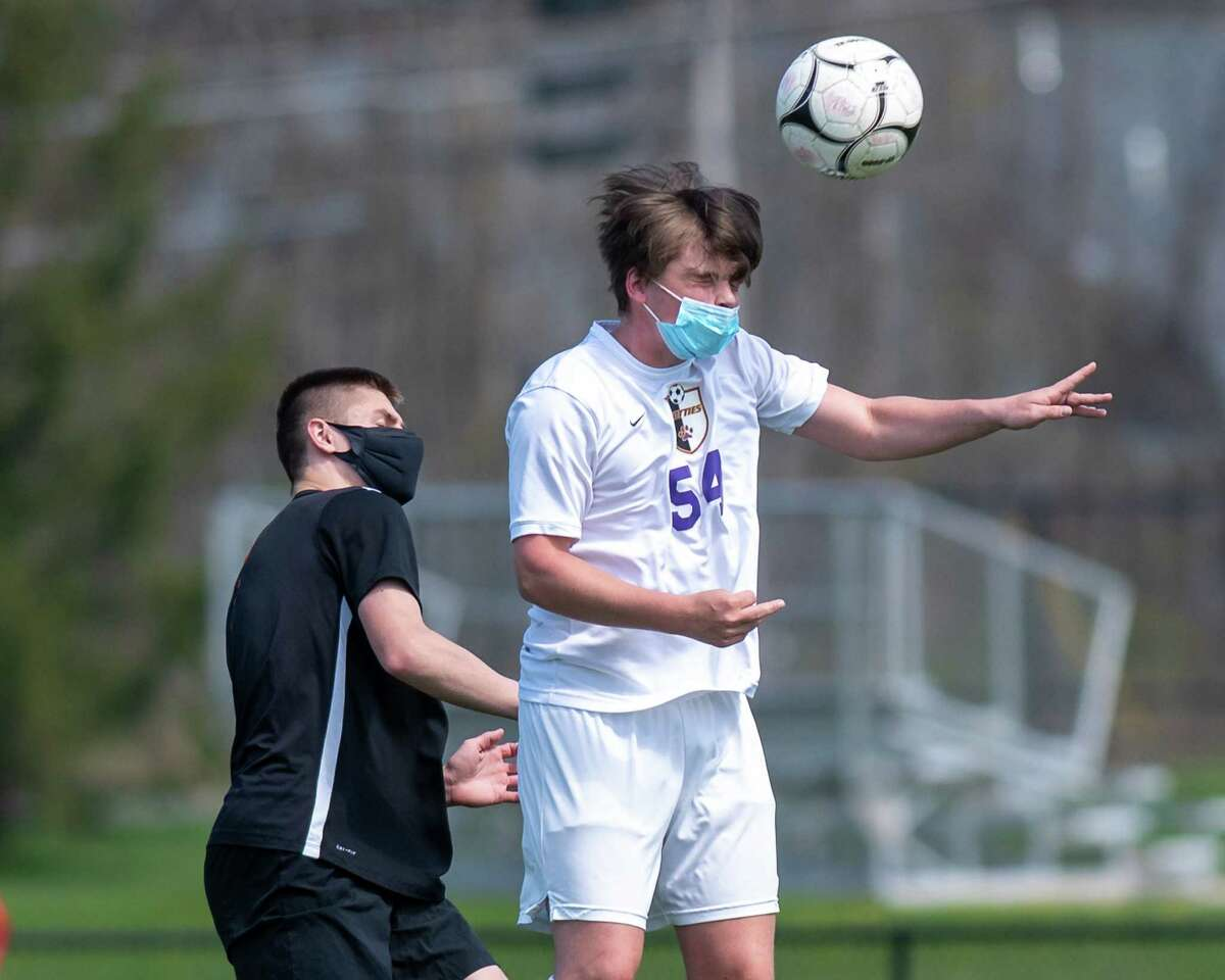 Ballston Spa senior John Buckley gets a head on the ball in front of Bethlehem senior Nolan Powers during a game at Bethlehem High School in Delmar, NY, on Saturday, April 24, 2021. (Jim Franco/Special to the Times Union)