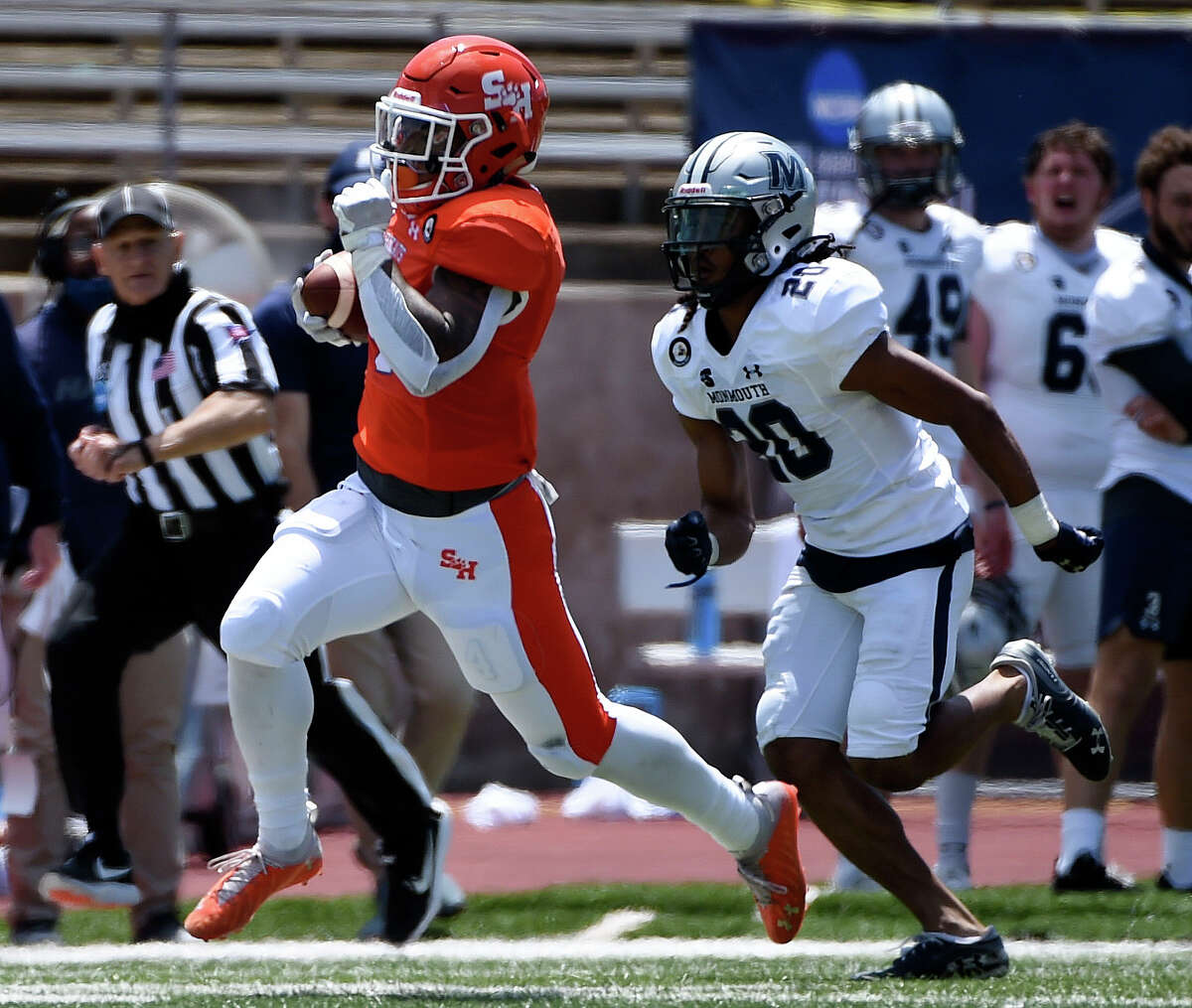 Sam Houston State running back Ramon Jefferson, left, runs past Monmouth defensive back Justin Terry (20) for a touchdown during the first half of a first round FCS college football playoff game, Saturday, April 24, 2021, in Huntsville, TX.