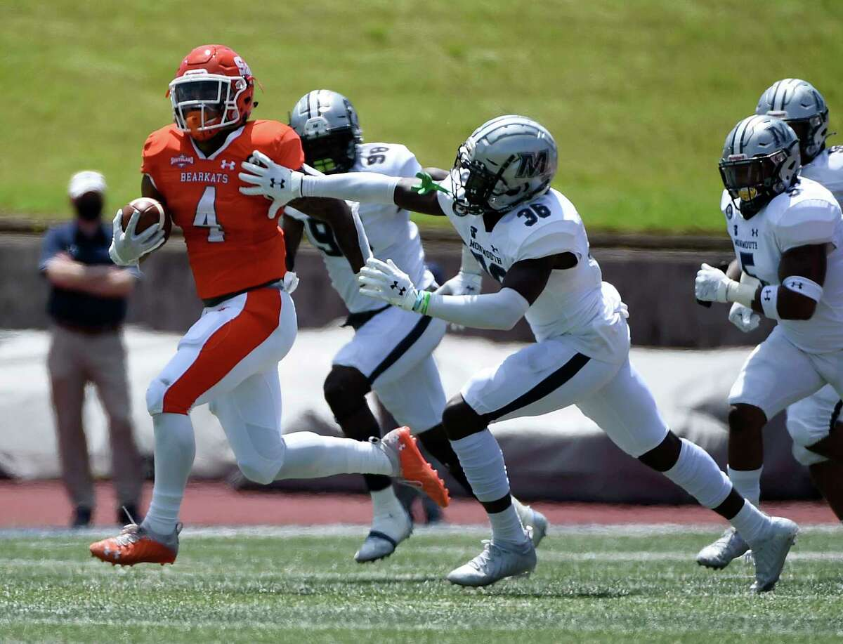 Sam Houston State running back Ramon Jefferson (4) runs past Monmouth defensive back Jason Antwi (36) en route to a touchdown during the first half of a first round FCS college football playoff game, Saturday, April 24, 2021, in Huntsville, TX.