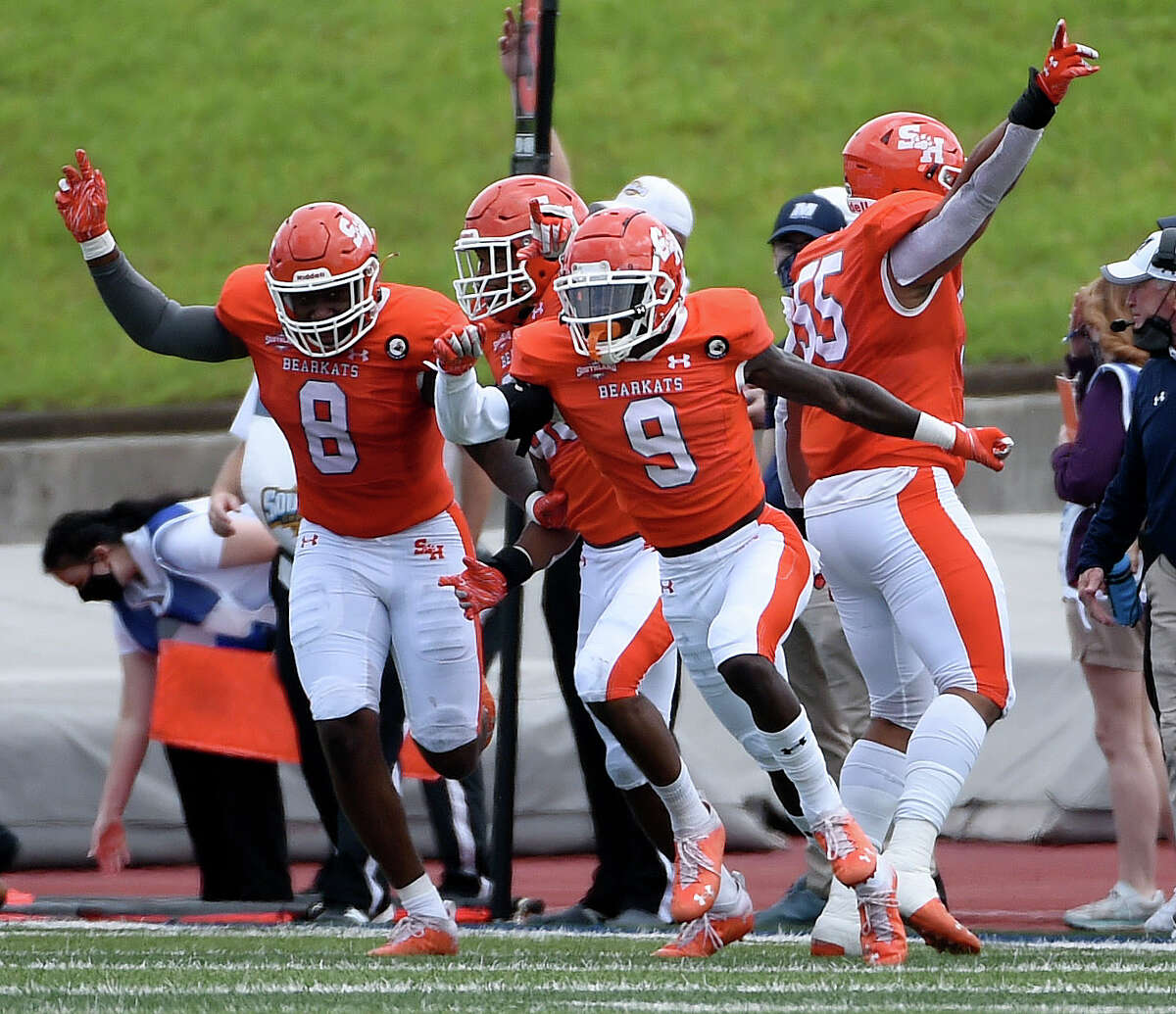 Sam Houston State defensive back Jaylen Thomas (9) celebrates his interception during the first half of a first round FCS college football playoff game against Monmouth, Saturday, April 24, 2021, in Huntsville, TX.