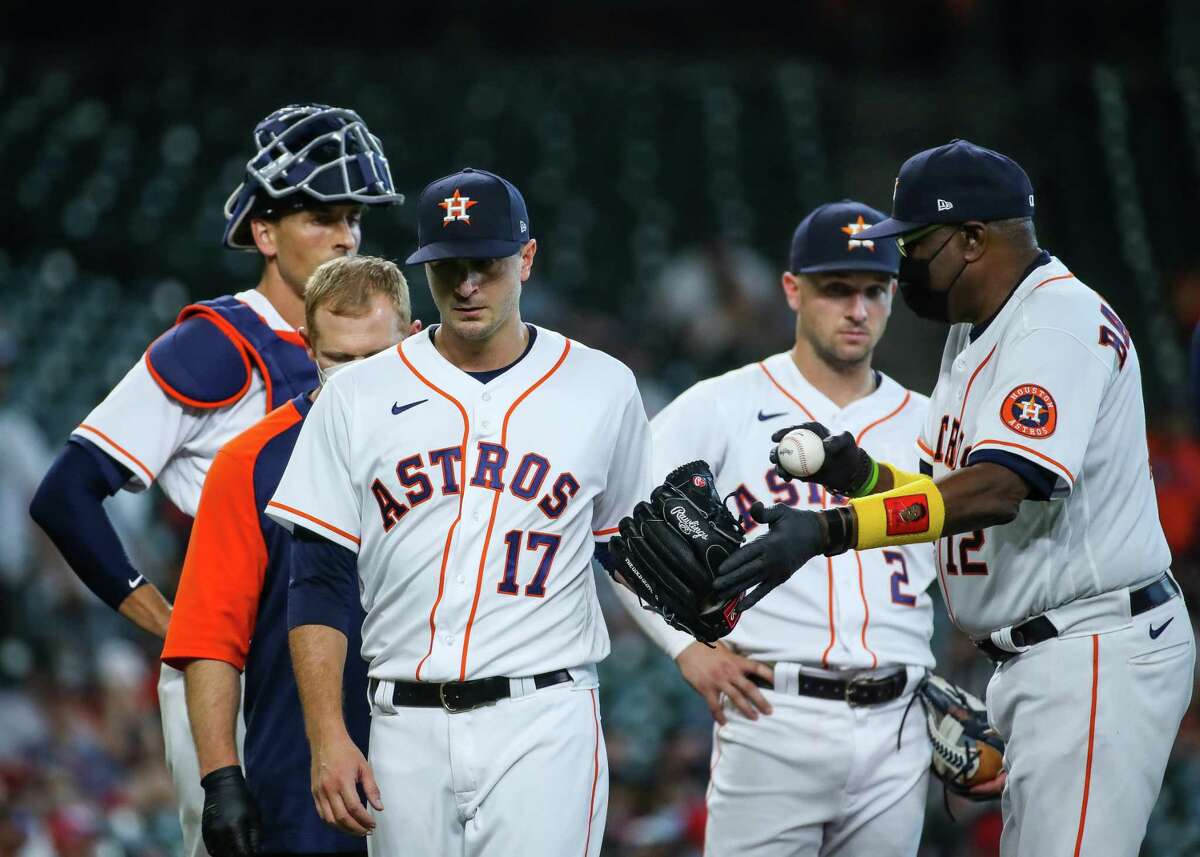 Houston Astros starting pitcher Jake Odorizzi (17) exits the game after facing one Los Angeles Angels batter in the first inning of an MLB game at Minute Maid Park on Saturday, April 24, 2021, in Houston.