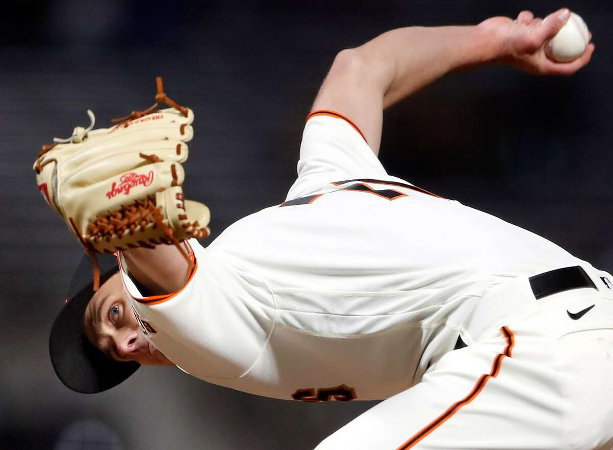 San Francisco Giants' reliever Tyler Rogers pitches against Miami Marlins in 8th inning of MLB game at Oracle Park in San Francisco, Calif., on Thursday, April 22, 2021.