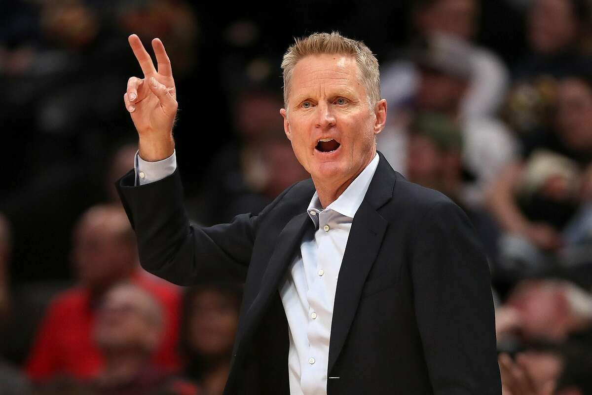 Golden State Warriors head coach Steve Kerr works the sidelines during a 2020 game against the Denver Nuggets at the Pepsi Center in Denver. The teams met again on Friday, April 23, 2021, in San Francisco with Kerr's Warriors coming away 118-97 winners. (Matthew Stockman/Getty Images/TNS)