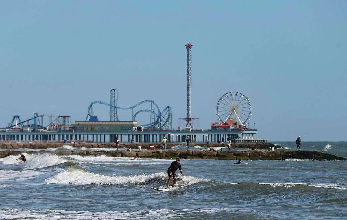 People enjoy the beach in Galveston on Nov. 22, 2020.