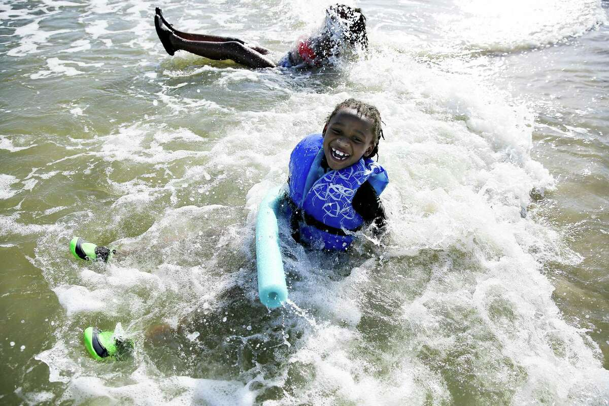 Michael Phillips, 7, of Temple, Texas enjoys the beach with his sister, Ariunna, 13, during spring break in Galveston on March 17, 2021.