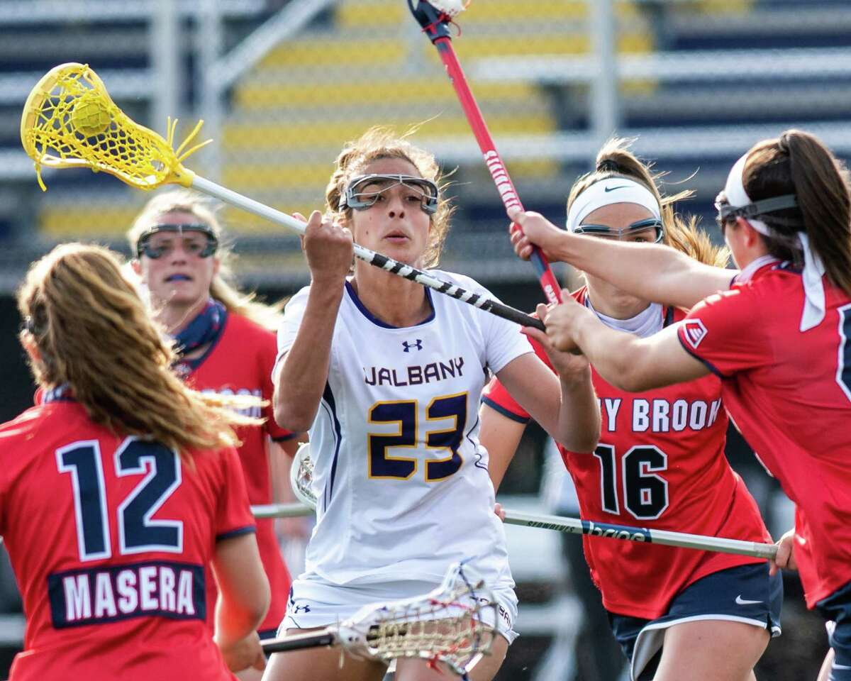 UAlbany freshman Katie Pascale is surrounded by four Stony Brook defenders during a game at John Fallon Field on the UAlbany campus in Albany, NY, on Saturday, April 24, 2021. (Jim Franco/Special to the Times Union)