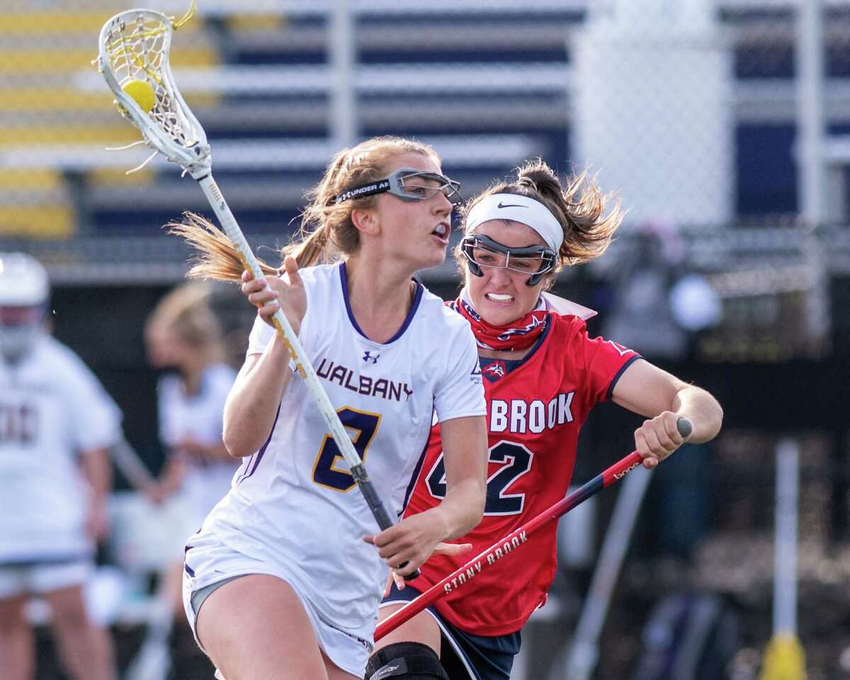 UAlbany senior Kendra Harbinger makes a move in front of Stony Brook freshman Clare Levy during a game at John Fallon Field on the UAlbany campus in Albany, NY, on Saturday, April 24, 2021. (Jim Franco/Special to the Times Union)