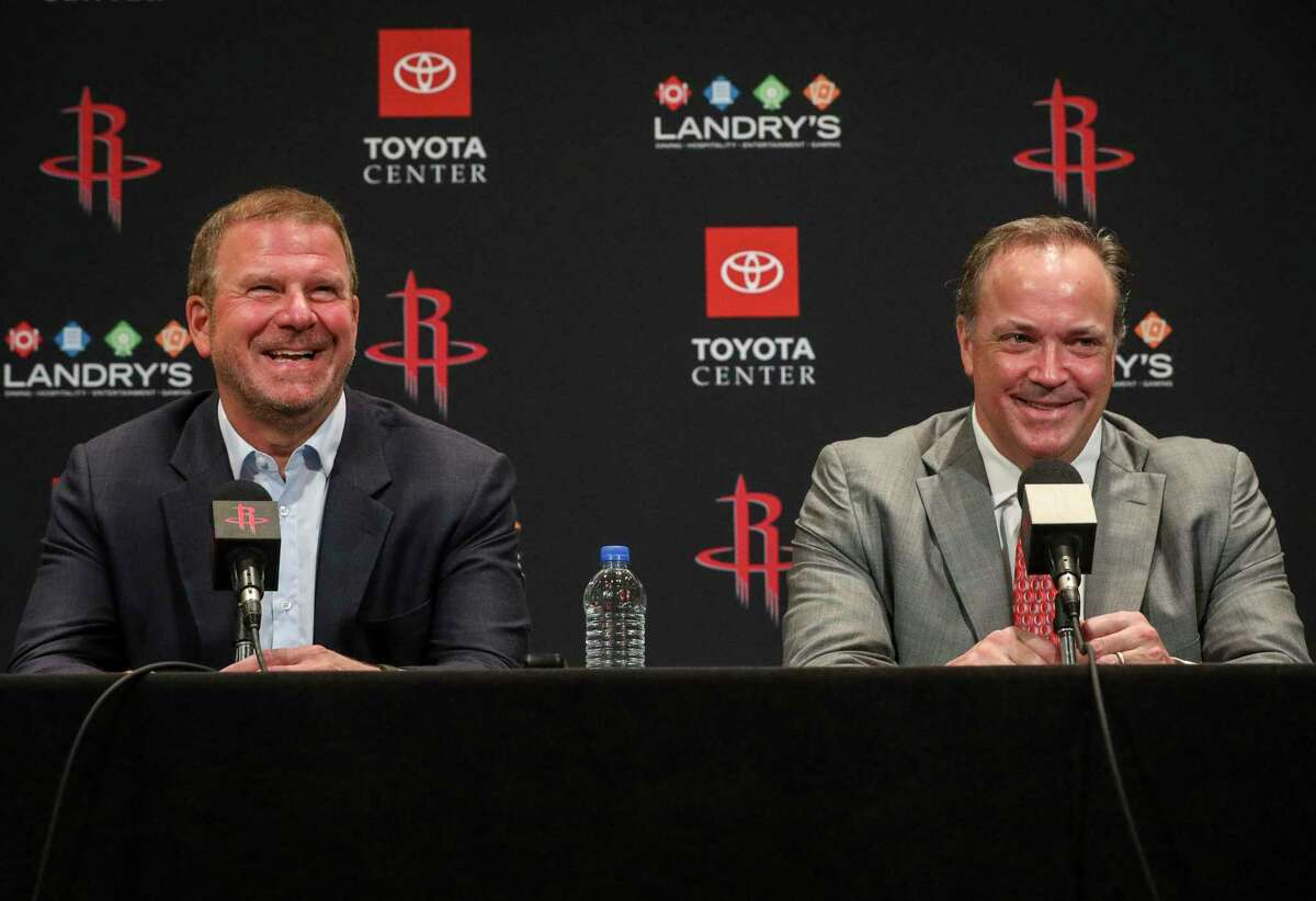 Rockets CEO Tad Brown, right, formed close bonds with star players such as Yao Ming and James Harden during his tenure.