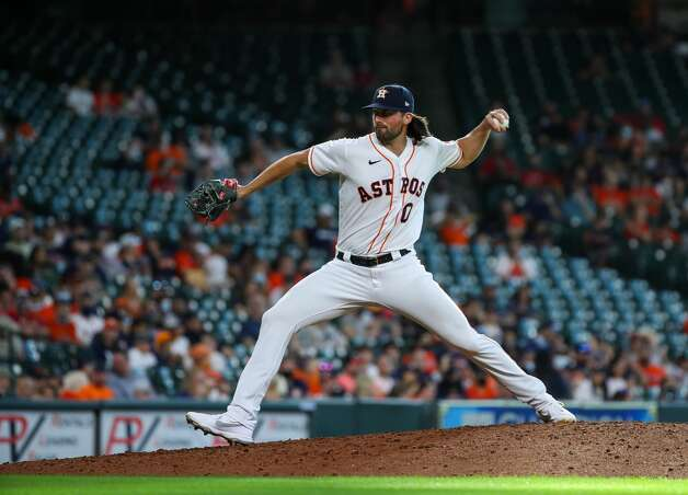 Houston Astros relief pitcher Kent Emanuel (0) throws against the Los Angeles Angels during the eighth inning of an MLB game at Minute Maid Park on Saturday, April 24, 2021, in Houston. Photo: Godofredo A Vásquez/Staff Photographer / © 2021 Houston Chronicle