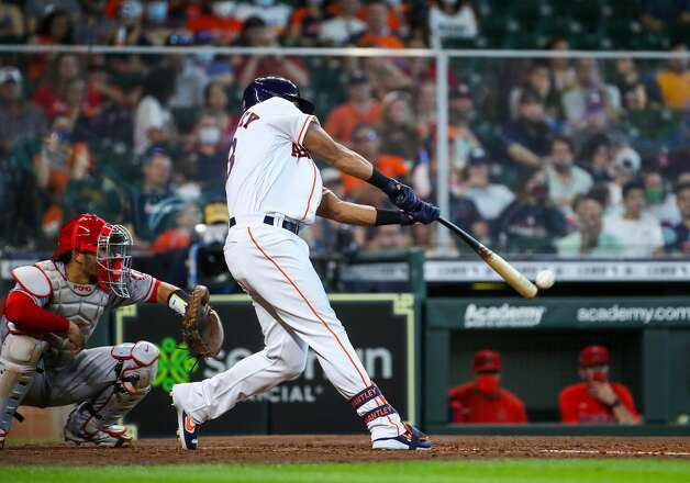 Houston Astros left fielder Michael Brantley (23) hits his third double of the game against the Los Angeles Angels in the fifth inning of an MLB game at Minute Maid Park on Saturday, April 24, 2021, in Houston. Photo: Godofredo A Vásquez/Staff Photographer / © 2021 Houston Chronicle