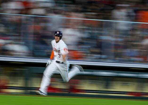 Houston Astros center fielder Myles Straw (3) rounds third base on his way to score off of a double hit by left fielder Michael Brantley (23) during the fourth inning of an MLB game against the Los Angeles Angels at Minute Maid Park on Saturday, April 24, 2021, in Houston. Photo: Godofredo A Vásquez/Staff Photographer / © 2021 Houston Chronicle