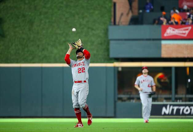 Los Angeles Angels third baseman David Fletcher (22) makes an out against Houston Astros shortstop Carlos Correa (1) during the fifth inning of an MLB game at Minute Maid Park on Saturday, April 24, 2021, in Houston. Photo: Godofredo A Vásquez/Staff Photographer / © 2021 Houston Chronicle
