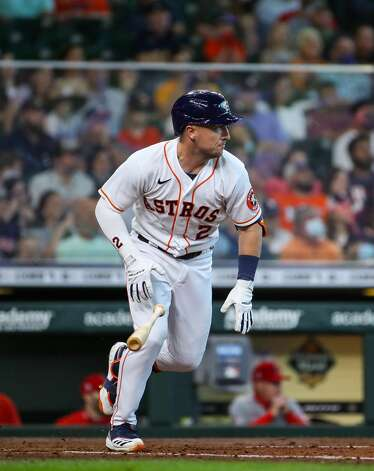 Houston Astros third baseman Alex Bregman (2) gets on base on a fielder's choice during the fourth inning of an MLB game against the Los Angeles Angels at Minute Maid Park on Saturday, April 24, 2021, in Houston. Bregman advanced to second base on an error by Los Angeles Angels catcher Kurt Suzuki (24). Photo: Godofredo A Vásquez/Staff Photographer / © 2021 Houston Chronicle