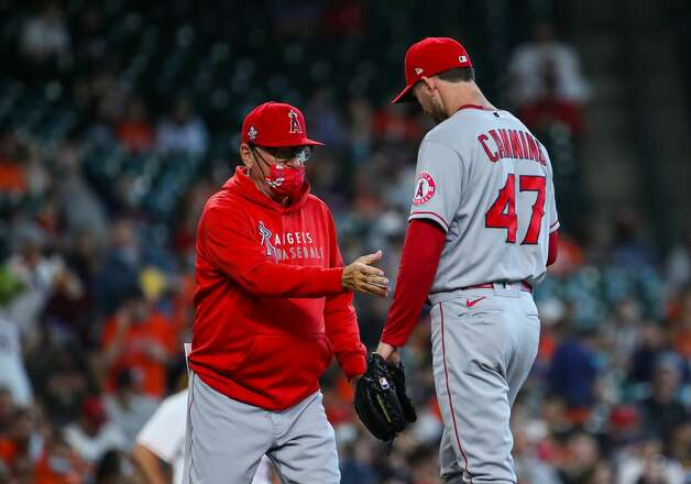 Los Angeles Angels manager Joe Maddon, left, takes out starting pitcher Griffin Canning (47) from an MLB game against the Houston Astros during the third inning at Minute Maid Park on Saturday, April 24, 2021, in Houston. Photo: Godofredo A Vásquez/Staff Photographer / © 2021 Houston Chronicle