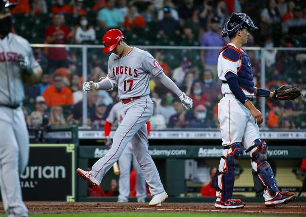 Los Angeles Angels designated hitter Shohei Ohtani (17) crosses home plate after hitting a solo home run against the Houston Astros during the third inning of an MLB game at Minute Maid Park on Saturday, April 24, 2021, in Houston. Photo: Godofredo A Vásquez/Staff Photographer / © 2021 Houston Chronicle