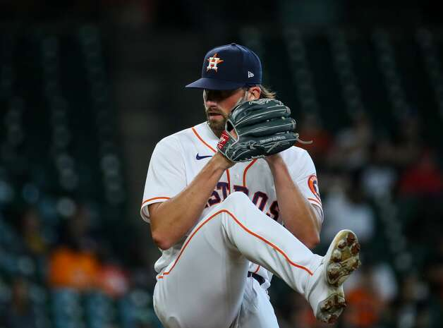 Houston Astros relief pitcher Kent Emanuel (0) throws against the Los Angeles Angels during the second inning of an MLB game at Minute Maid Park on Saturday, April 24, 2021, in Houston. Photo: Godofredo A Vásquez/Staff Photographer / © 2021 Houston Chronicle