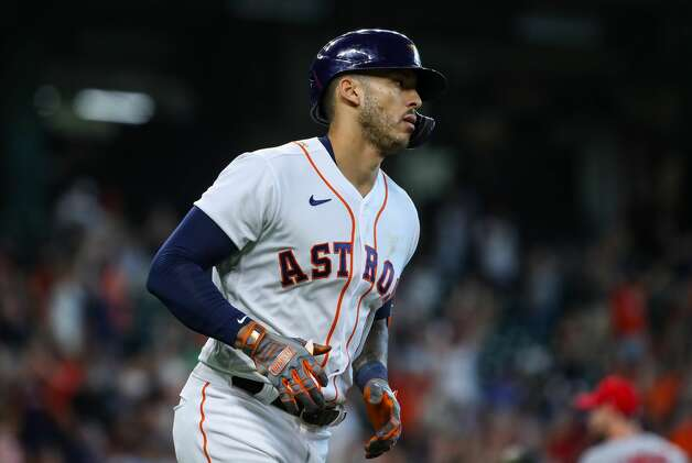 Houston Astros shortstop Carlos Correa (1) rounds the bases after hitting a solo home run against the Los Angeles Angels during the first inning of an MLB game at Minute Maid Park on Saturday, April 24, 2021, in Houston. Photo: Godofredo A Vásquez/Staff Photographer / © 2021 Houston Chronicle