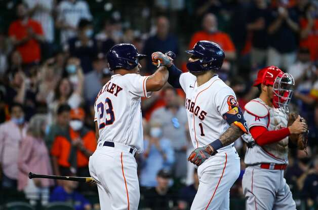 Houston Astros shortstop Carlos Correa (1) celebrates with left fielder Michael Brantley (23)after hitting a solo home run against the Los Angeles Angels during the first inning of an MLB game at Minute Maid Park on Saturday, April 24, 2021, in Houston. Photo: Godofredo A Vásquez/Staff Photographer / © 2021 Houston Chronicle