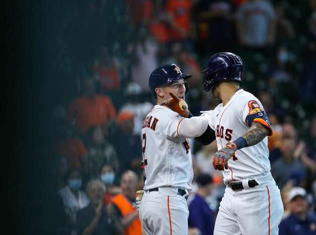 Houston Astros shortstop Carlos Correa (1) celebrates with third baseman Alex Bregman (2) after hitting a solo home run against the Los Angeles Angels during the first inning of an MLB game at Minute Maid Park on Saturday, April 24, 2021, in Houston. Photo: Godofredo A Vásquez/Staff Photographer / © 2021 Houston Chronicle