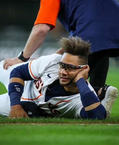 Houston Astros first baseman Yuli Gurriel (10) is worked on by a team trainer before an MLB game against the Los Angeles Angels at Minute Maid Park on Saturday, April 24, 2021, in Houston. Photo: Godofredo A Vásquez/Staff Photographer / © 2021 Houston Chronicle