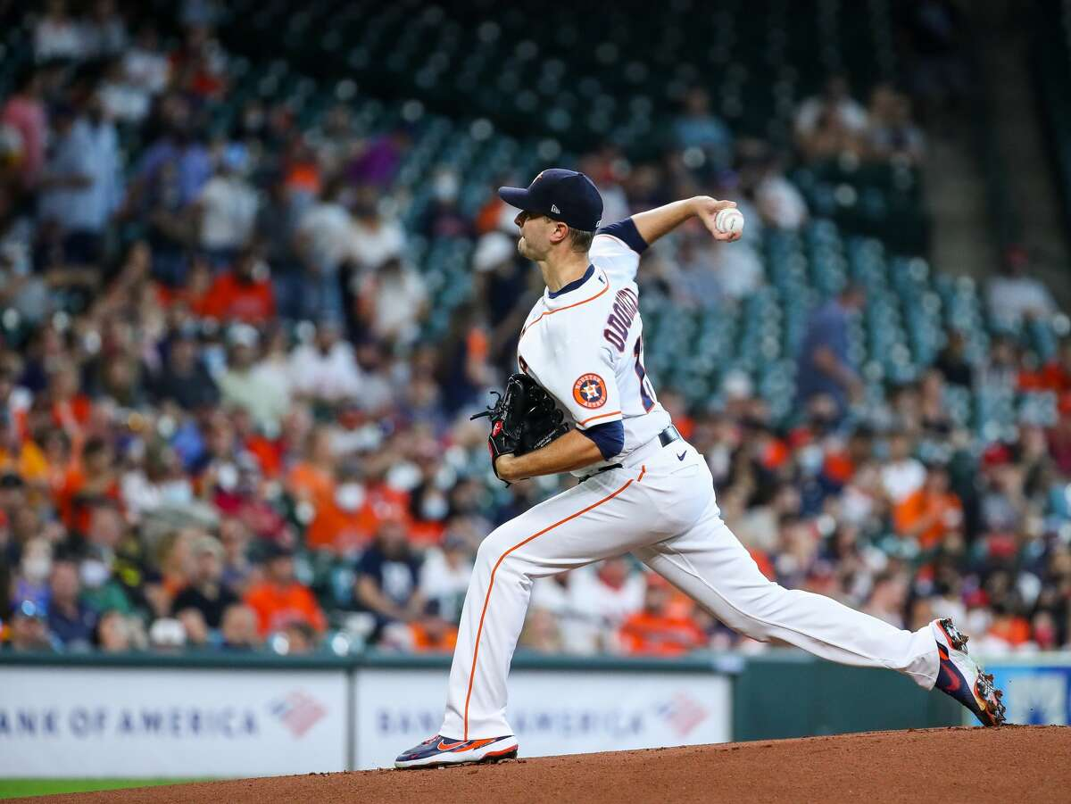 Houston Astros starting pitcher Jake Odorizzi (17) throws against the Los Angeles Angels during the first inning of an MLB game at Minute Maid Park on Saturday, April 24, 2021, in Houston.