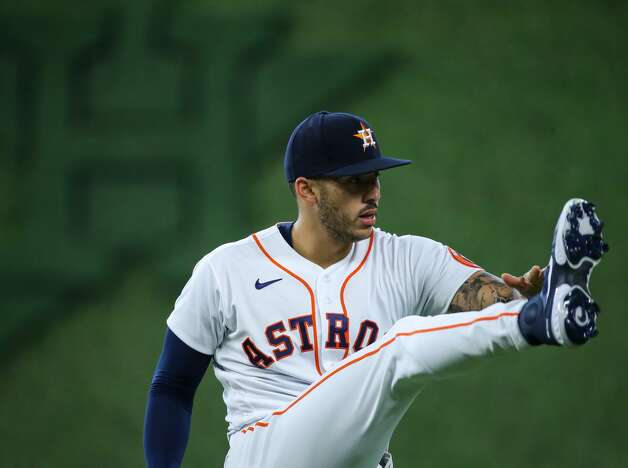 Houston Astros shortstop Carlos Correa (1) stretches before an MLB game against the Los Angeles Angels at Minute Maid Park on Saturday, April 24, 2021, in Houston. Photo: Godofredo A Vásquez/Staff Photographer / © 2021 Houston Chronicle