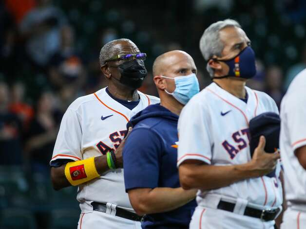 Houston Astros manager Dusty Baker Jr. (12) listens to the national anthem before an MLB game against the Los Angeles Angels at Minute Maid Park on Saturday, April 24, 2021, in Houston. Photo: Godofredo A Vásquez/Staff Photographer / © 2021 Houston Chronicle