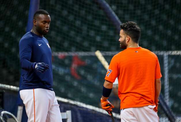 Houston Astros designated hitter Yordan Alvarez (44) talks with second baseman Jose Altuve (27) during batting practice before an MLB game between the Astros and the Los Angeles Angels at Minute Maid Park on Saturday, April 24, 2021, in Houston. Altuve is not yet back in the lineup since being placed in the COVID-19 list on April 14. Photo: Godofredo A Vásquez/Staff Photographer / © 2021 Houston Chronicle