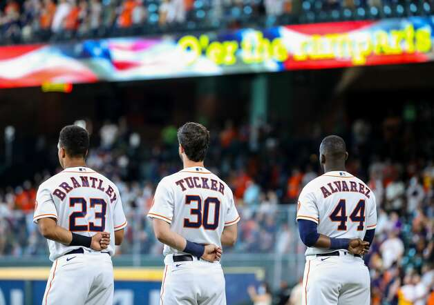 Houston Astros left fielder Michael Brantley (23), right fielder Kyle Tucker (30), and designated hitter Yordan Alvarez (44) listen to the national anthem before an MLB game against the Los Angeles Angels at Minute Maid Park on Saturday, April 24, 2021, in Houston. Photo: Godofredo A Vásquez/Staff Photographer / © 2021 Houston Chronicle