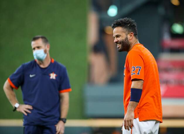 Houston Astros second baseman Jose Altuve (27) smiles while training on the field before an MLB game between the Astros and the Los Angeles Angels at Minute Maid Park on Saturday, April 24, 2021, in Houston. Altuve is not yet back in the lineup since being placed in the COVID-19 list on April 14. Photo: Godofredo A Vásquez/Staff Photographer / © 2021 Houston Chronicle