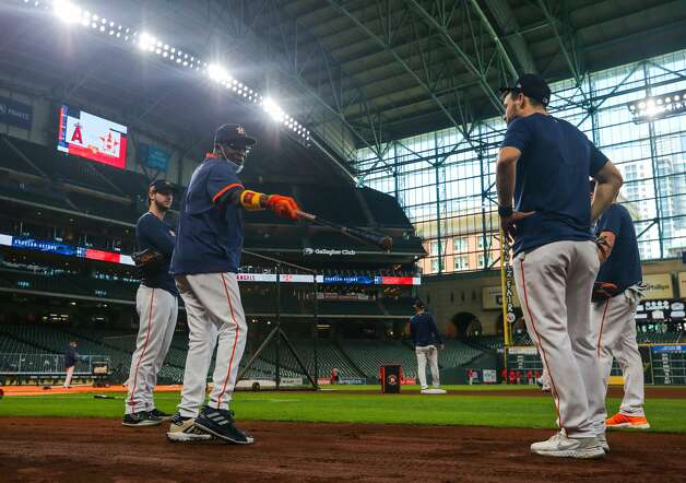 Houston Astros manager Dusty Baker Jr. (12) talks to some of his players during practice before an MLB game between the Astros and the Los Angeles Angels at Minute Maid Park on Saturday, April 24, 2021, in Houston. Photo: Godofredo A Vásquez/Staff Photographer / © 2021 Houston Chronicle