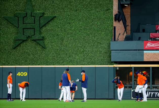 Houston Astros players stretch in the outfield during before an MLB game between the Astros and the Los Angeles Angels at Minute Maid Park on Saturday, April 24, 2021, in Houston. Photo: Godofredo A Vásquez/Staff Photographer / © 2021 Houston Chronicle