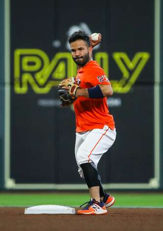 Houston Astros second baseman Jose Altuve (27) throws to first base as he fielded some ground balls before an MLB game between the Astros and the Los Angeles Angels at Minute Maid Park on Saturday, April 24, 2021, in Houston. Altuve is not yet back in the lineup since being placed in the COVID-19 list on April 14. Photo: Godofredo A Vásquez/Staff Photographer / © 2021 Houston Chronicle