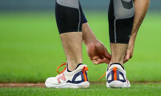 Houston Astros second baseman Jose Altuve (27) ties his shoelaces as he takes the field for some training before an MLB game between the Astros and the Los Angeles Angels at Minute Maid Park on Saturday, April 24, 2021, in Houston. Altuve is not yet back in the lineup since being placed in the COVID-19 list on April 14. Photo: Godofredo A Vásquez/Staff Photographer / © 2021 Houston Chronicle