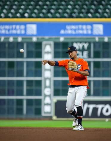 Houston Astros second baseman Robel Garcia (9) throws to first base during batting practice, before an MLB game between the Astros and the Los Angeles Angels at Minute Maid Park on Saturday, April 24, 2021, in Houston. Photo: Godofredo A Vásquez/Staff Photographer / © 2021 Houston Chronicle