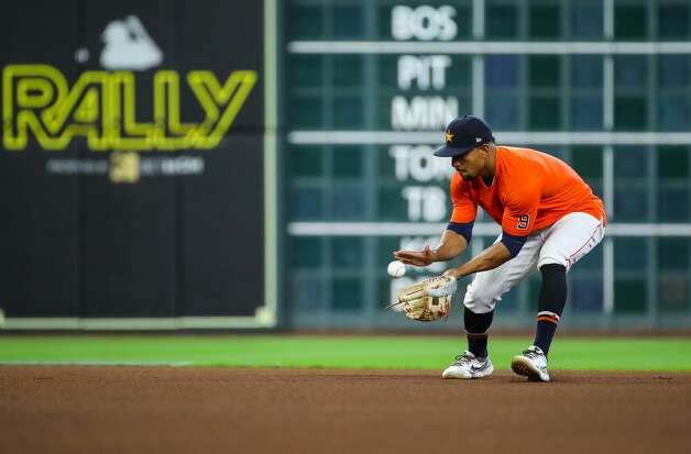 Houston Astros second baseman Robel Garcia (9) fields a ground ball during batting practice, before an MLB game between the Astros and the Los Angeles Angels at Minute Maid Park on Saturday, April 24, 2021, in Houston. Photo: Godofredo A Vásquez/Staff Photographer / © 2021 Houston Chronicle