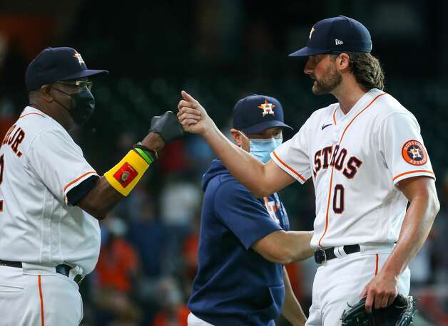 Houston Astros manager Dusty Baker Jr. (12) celebrates with relief pitcher Kent Emanuel (0) after defeating the Los Angeles Angels in an MLB game at Minute Maid Park on Saturday, April 24, 2021, in Houston. The Astros won 16-2. Photo: Godofredo A Vásquez/Staff Photographer / © 2021 Houston Chronicle