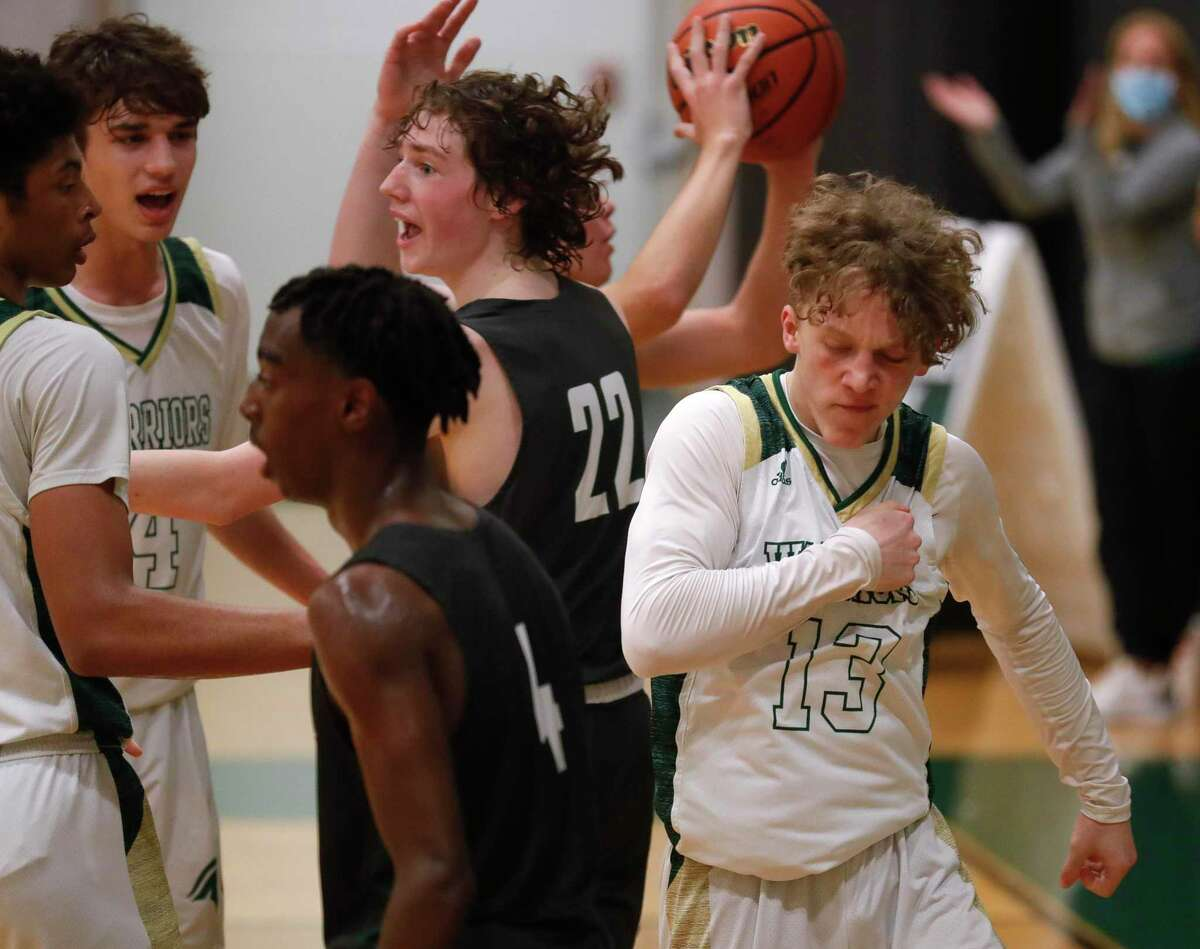 The Woodlands Christian Academy junior Austin Benigni (13) is The Courier's Player of the Year. Benigni averaged 20 points, 4.8 rebounds, 4 assists and 2.6 steals per game he led the Warriors to the TAPPS Class 5A state title.