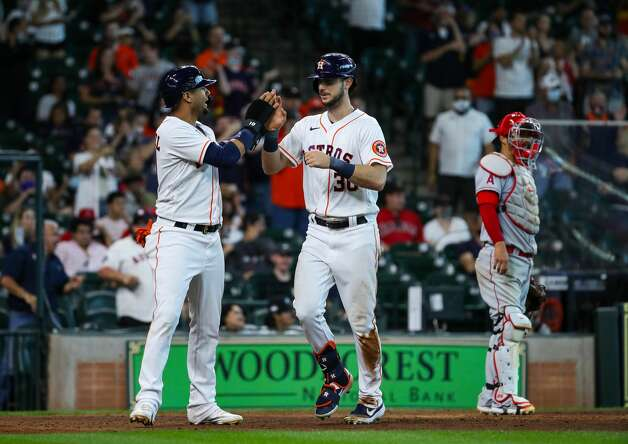 Houston Astros right fielder Kyle Tucker (30) celebrates with first baseman Yuli Gurriel (10) after hitting a two-run home run against the Los Angeles Angels during the eighth inning of an MLB game at Minute Maid Park on Saturday, April 24, 2021, in Houston. Photo: Godofredo A Vásquez/Staff Photographer / © 2021 Houston Chronicle