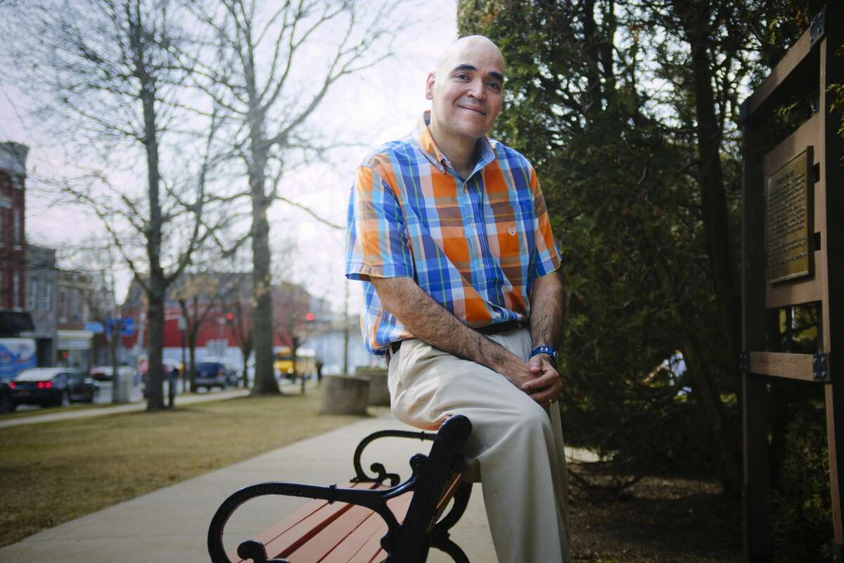 Pedro Rodriguez, a substance abuse counselor and life coach for the corrections department, enjoys a springtime day in a park near his home in the small, historic city of Johnstown. Rodriguez is a Christian but the stresses of his job and the pandemic left him needing more spiritual development than church could provide. He adds candidly that he founded the Circle for men because he felt a bit out of place since so few congregations had Hispanic members. (Paul Buckowski/Times Union)