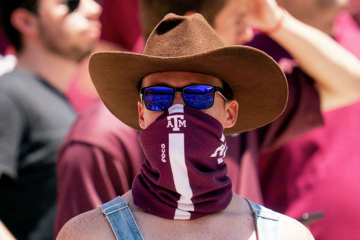 A Texas A&M fan looks on as the Aggies march down Kyle Field during the Texas A&M Maroon and White Spring game in College Station, Texas on Saturday, April 24, 2021. (Sam Craft)