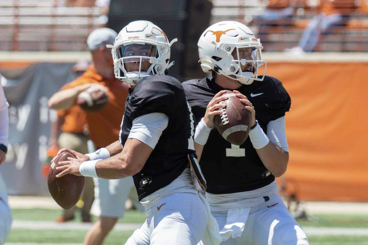 Texas quarterbacks Casey Thompson, left, and Hudson Card warm up before the Texas Orange and White Spring Scrimmage football game in Austin, Texas, Saturday, April 24, 2021. (AP Photo/Michael Thomas)