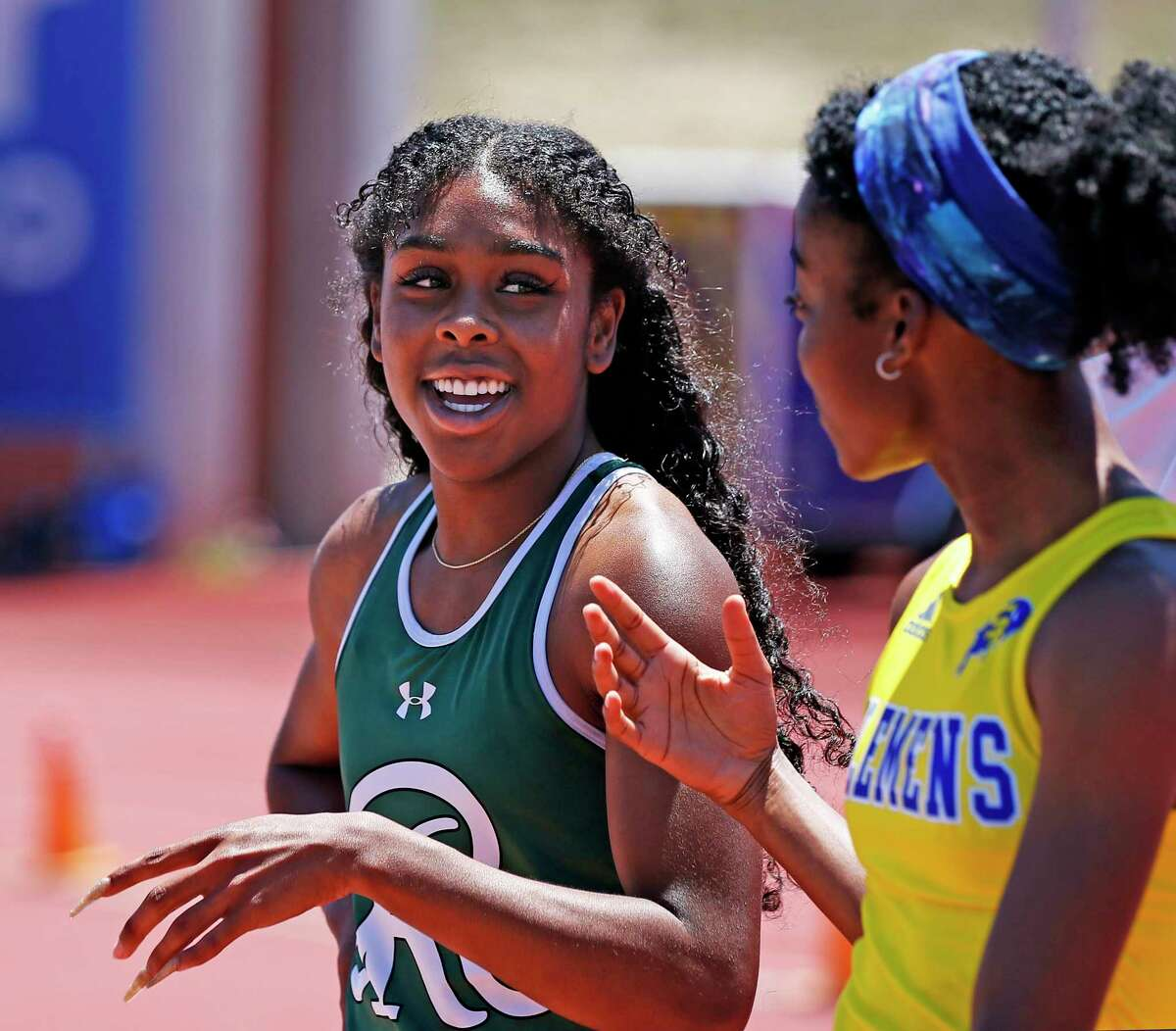 Reagan Jasmine Montgomery is all smiles as she talks with Saniya Friendly,Clements. Jasmine just won the 100 meter dash 6A. Region IV-6A/5A at Heroes Stadium on Saturday, April 24, 2021
