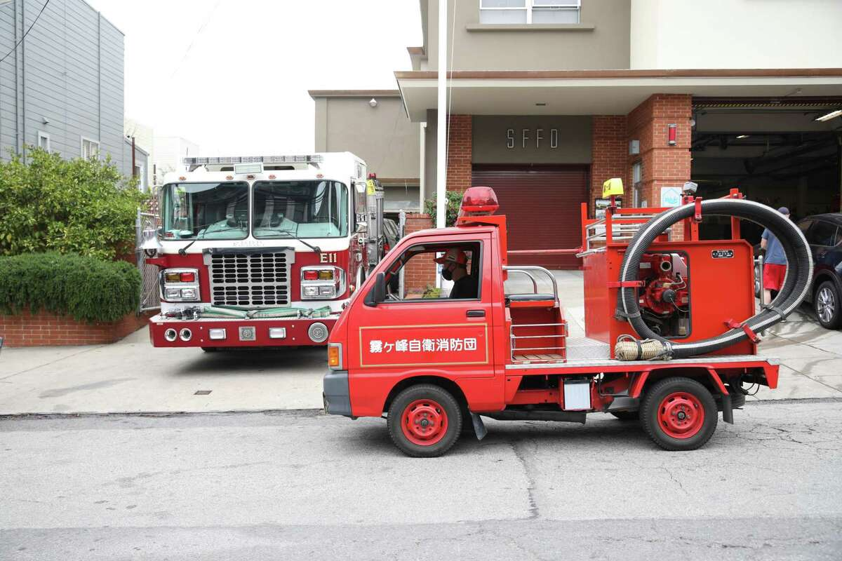 Todd Lappin drives his tiny Japanese fire truck in front of the San Francisco Fire Department's Station 11. Shipped from Japan last year, Kiri the truck is 2 feet shorter than a Mazda Miata, climbs S.F. hills like a mountain goat and can actually fight fires.