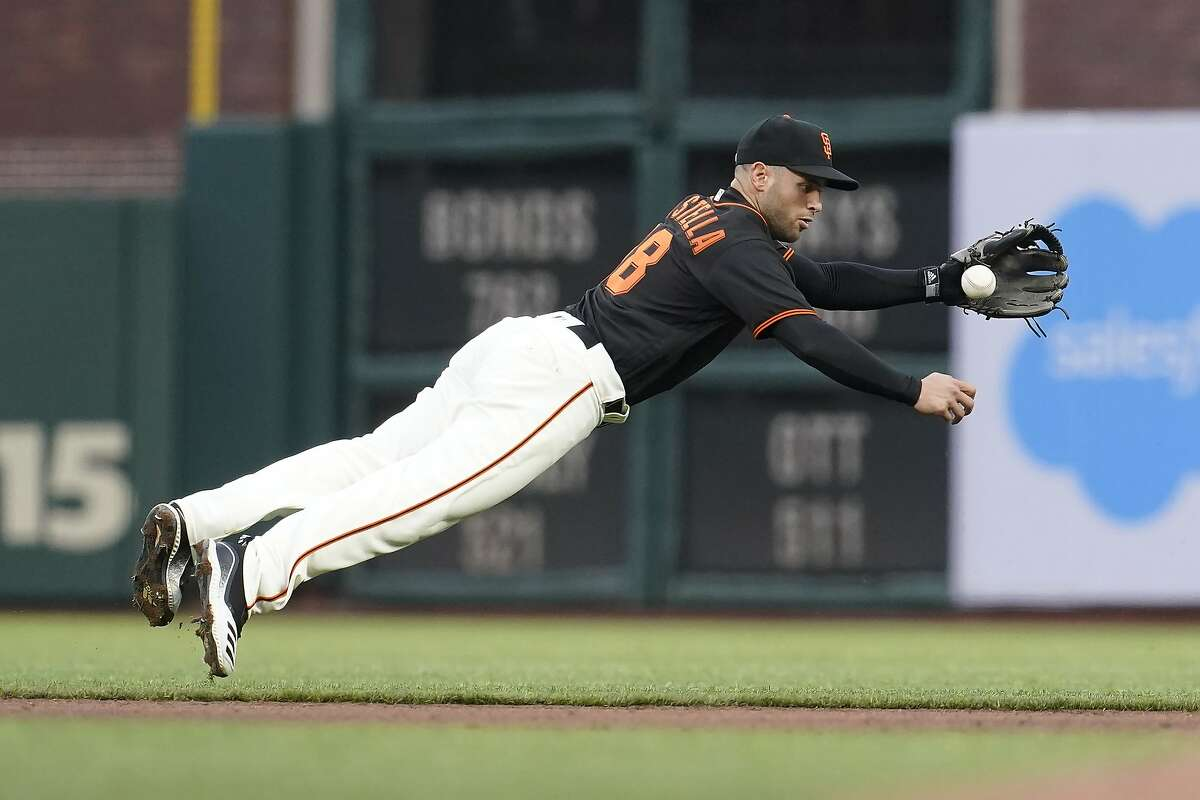 San Francisco Giants second baseman Tommy La Stella fields a ground out hit by Miami Marlins' Jesus Aguilar during the fourth inning of a baseball game in San Francisco, Saturday, April 24, 2021. (AP Photo/Jeff Chiu)
