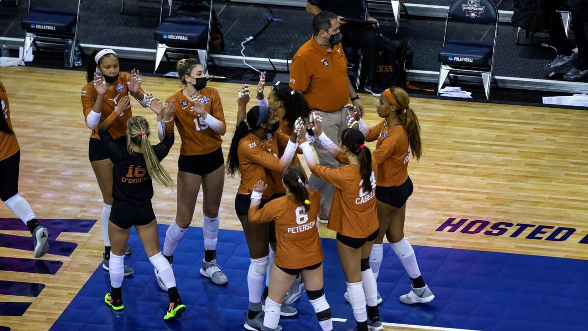 Texas players gather after a loss to Kentucky during the final in the NCAA women's volleyball championships Saturday, April 24, 2021, in Omaha, Neb. (AP Photo/John Peterson)