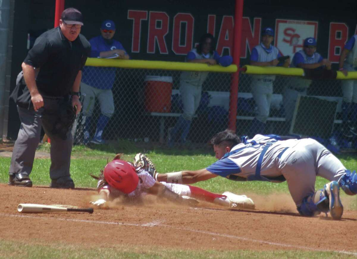 Channelview's catcher makes the extremely dramatic tag at the plate on South Houston's Ryan Robertson in the seventh inning Saturday. Had Robertson scored, the Trojans would have clinched a state playoff berth.